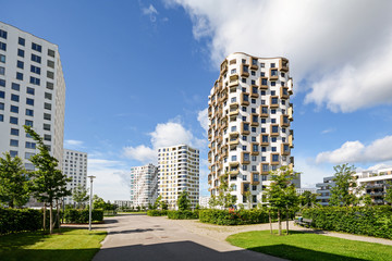 Apartment towers in the city - modern residential buildings with low energy house standard Wall mural