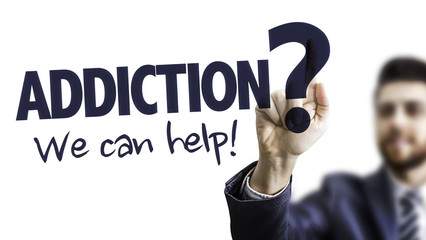 Business Man Pointing the Text: Addiction? We Can Help!