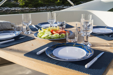 breakfast on yacht, dinning table on the upper deck in luxurious yacht