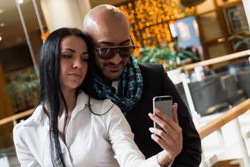 Arab businessman and girl making selfie