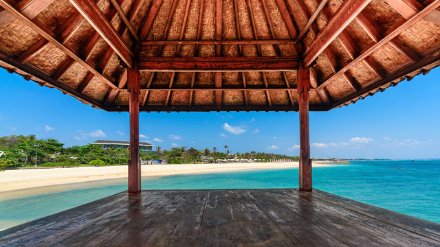 Looking out of a hut on a beautiful day at a tropical beach in Bali, Indonesia.