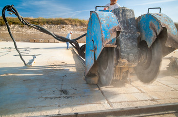Circular sawing machine in action in a tufa quarry while carving the stone