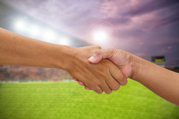 handshake in a business opponent team players shaking hand on fo
