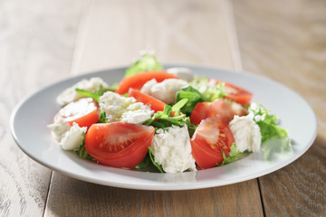 summer light salad with tomatoes, mozzarella and rocket leaves
