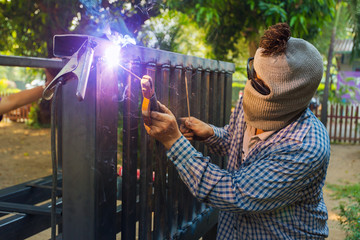 Man welding steel construction