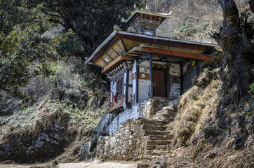 Temple along the footpath to the Tiger Nest, Paro, Bhutan - The small temple built on the birth place of Je Khempo Geshey Guenden Rinchen, Paro, Bhutan.