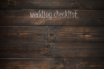 word wedding checklist  written on a wooden plate