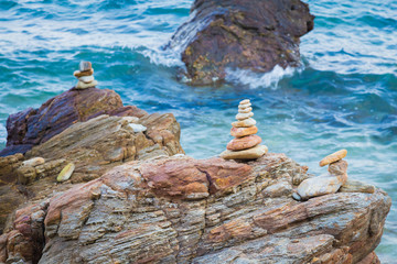Stone stack on the rock with ocean background