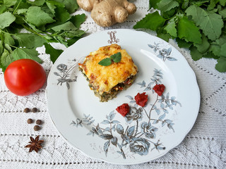 Quinoa tomato ginger gratin on plate, organic food with weed