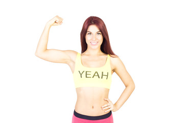 Sport smiling woman shows off his muscles. Sports and fitness concept.