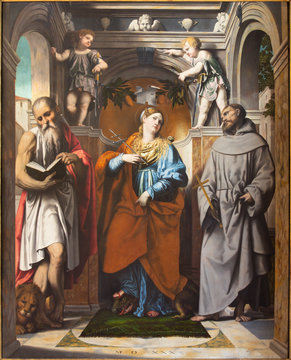 BRESCIA, ITALY - MAY 22, 2016: The pain of St. Margaret of Antioch, St. Francis of Assisi, and St. Jerome in church Chiesa di San Francesco d'Assisi by Alessandro Bonvicino - Moretto (1498 - 1554)