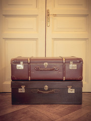 Vintage suitcase on the floor. Pastel color