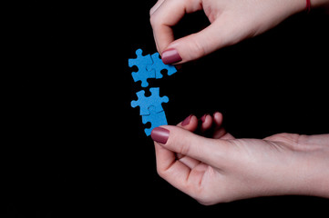 Female hands connecting puzzle pieces - can be isolated