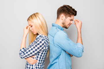 Man and woman standing back to back after quarrel
