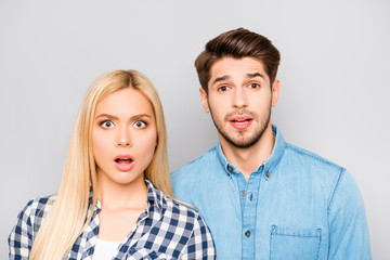 Shocked funny young couple  opening mouth