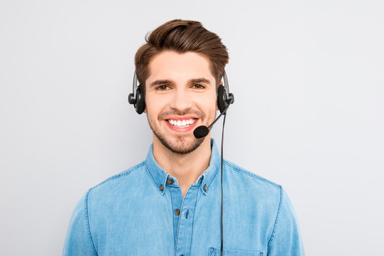handsome young man in work in  call-centre with headphones and s