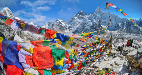 View of Mount Everest and Nuptse  with buddhist prayer flags from kala patthar in Sagarmatha National Park in the Nepal Himalaya
