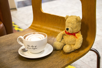 Bear with coffee cup
