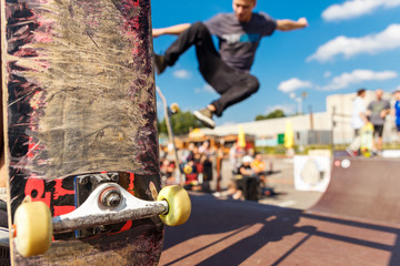 Competitions for skateboarding and scratched skateboard.