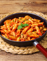 Penne with roasted chicken in tomato sauce