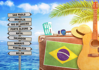 Concept of summer traveling with old suitcase and Brazil town si
