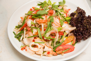spicy salad with  squid onion, green herbs and tomato
