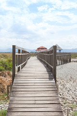 perspective wooden bridge with dry earth and cracked ground texture, broken split land with soil background