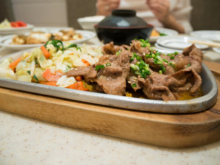 Beef with vegetables on hot plate, beef teppanyaki Japanese Cook