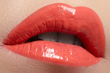 Woman's lips with red lipstick. Beauty and fashion