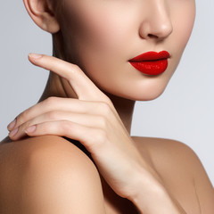 Beautiful young model with red lips and french manicure