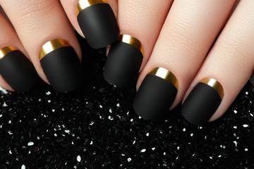 Black matte nail polish. Manicured nail with black matte nail polish