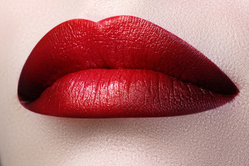 Close-up shot of woman lips with red lipstick