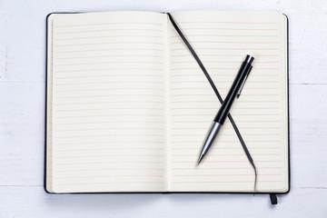 White notepad notebook lines elegant pen wooden background