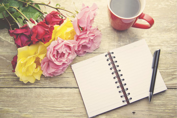 roses,coffee and notebook