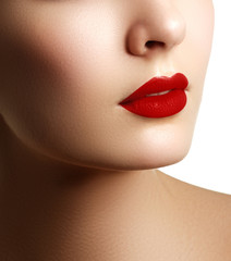 Close-up shot of woman lips with red lipstick. Beautiful perfect makeup