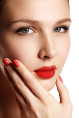 Beautiful woman young model with red lips and red manicure