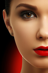 Beautiful fashion woman model face portrait with red lipstick