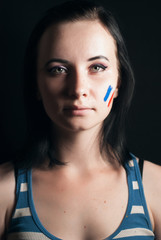 Painted woman face with flag of France