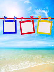 colorful polaroid blank paper for add text or picture on the beautiful beach.
