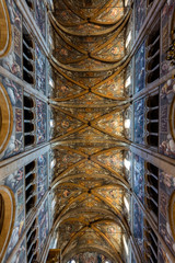 12th-century Romanesque Parma cathedral filled with Renaissance art. Its ceiling fresco by Correggio is considered a masterpiece of Renaissance fresco work.