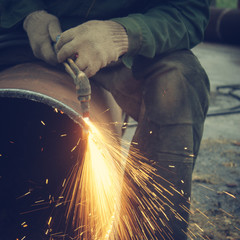 Metal cutting with acetylene torch.