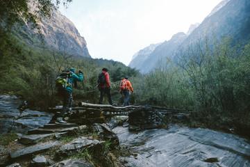 Group of hikers crossing the bridge
