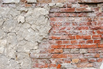 Vintage red brick wall with sprinkled white plaster texture background