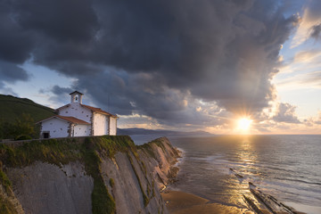San Telmo chapel and beach of Itzurun in Zumaia at sunset. Basque Country