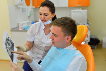 Dentist explaining x ray picture to patient