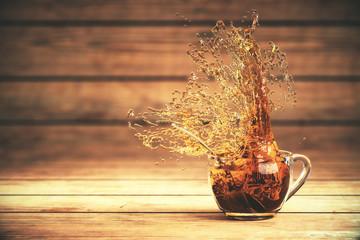 Splashing tea on wood
