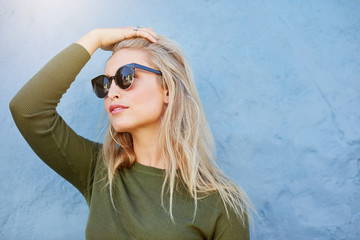 Young blonde in sunglasses looking away
