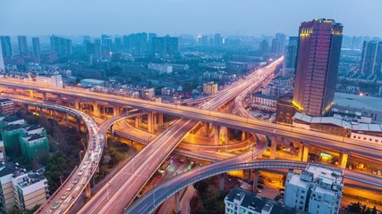 Fotomurales - city highway overpass in hangzhou ,  time lapse of bright lights and traffic at dusk to night
