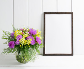 Flowers in glass vase with motivational frame