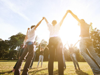 large group of friends tohether in a park having fun
